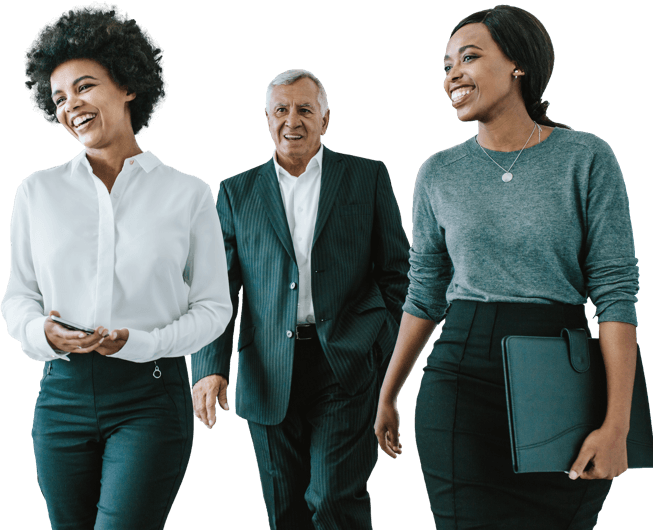 Three people in business attire walk and smile